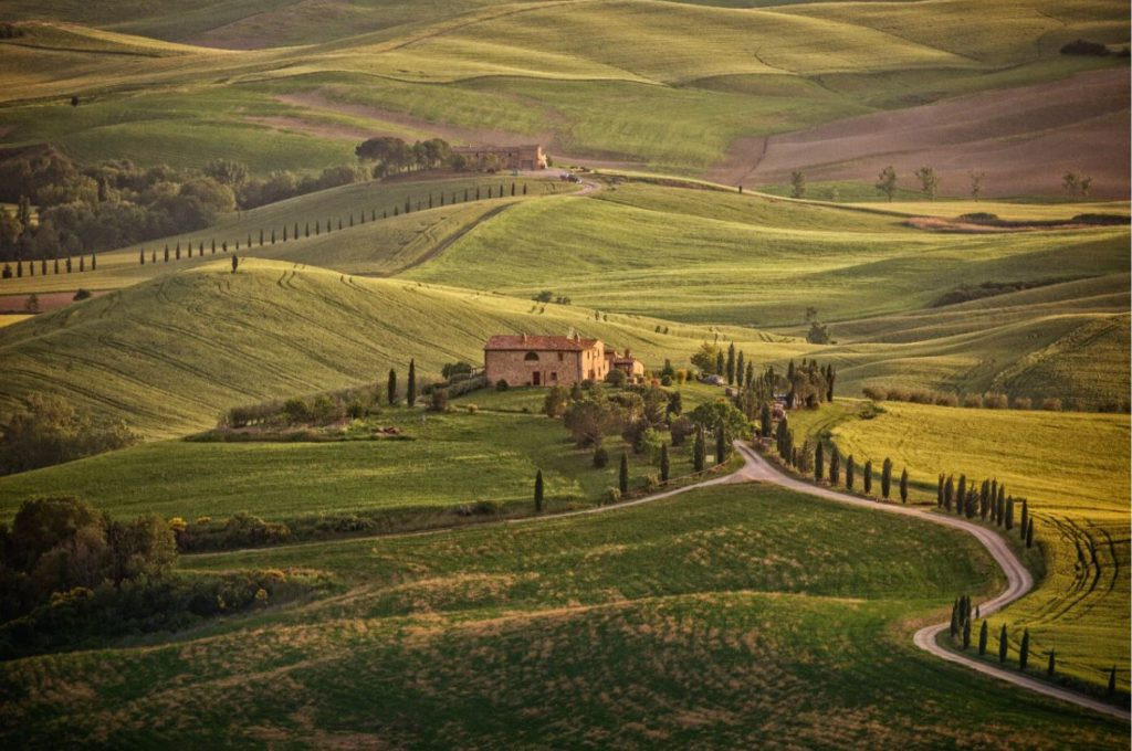 Landscape and farmhouse in the hills of Val d'Orcia, Tuscany, Italy