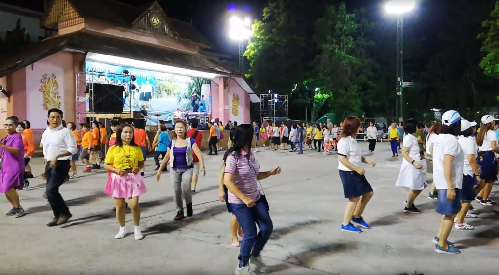 Locals dancing at a gathering in Chiang Rai