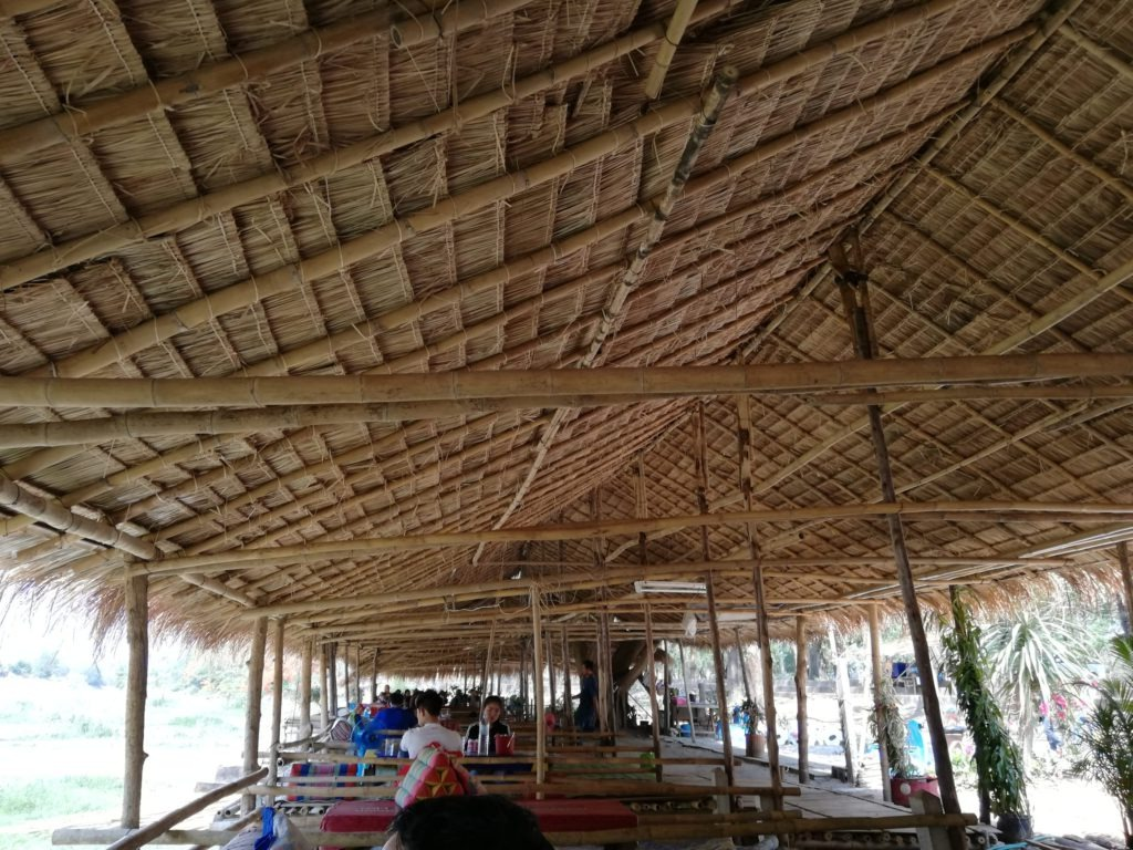 Bamboo huts next to the river bed at Chiang Rai Beach