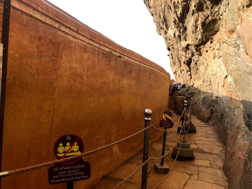 The mirror wall at Sigiriya reflects the artworks on the opposite wall