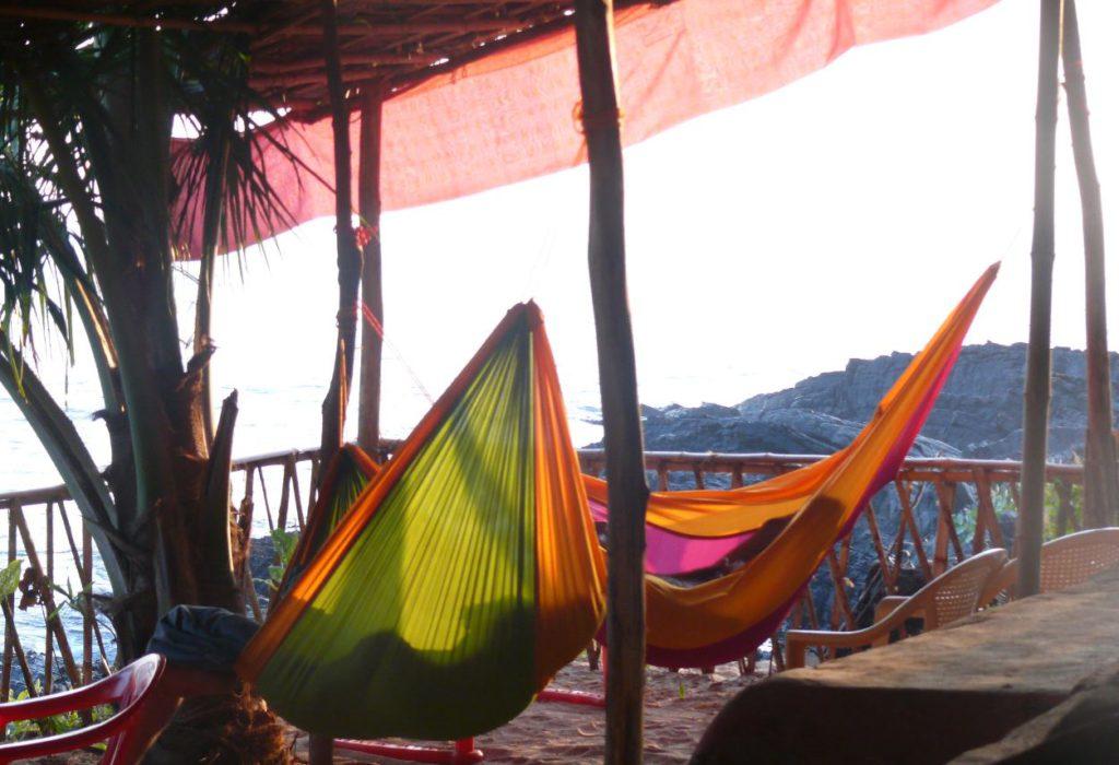 Tourists lying on the hammock in Gokarna