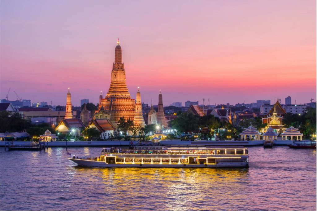Wat Arun after sunset with cruise on Chao Phraya river