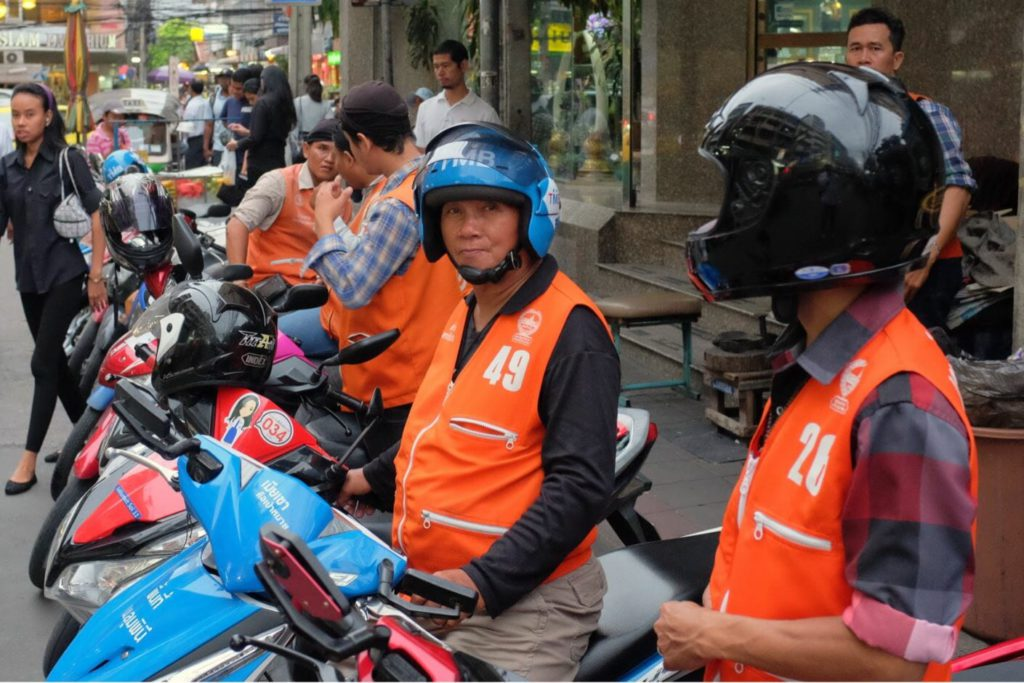 Motorcycle taxis in Bangkok at a taxi stand