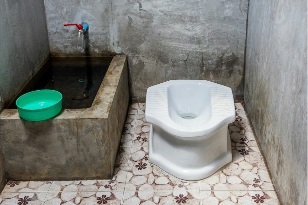 A squat style toilet in South-East Asia