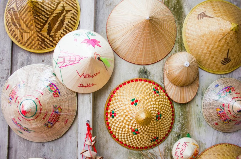 traditional straw hats in Vietnam worn by paddy farmers