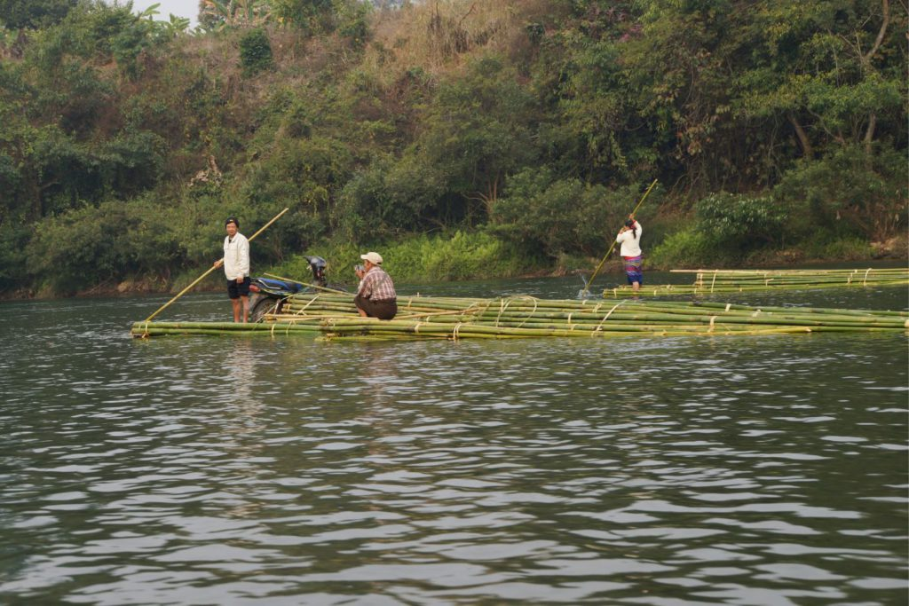 People on Bamboo Rafts