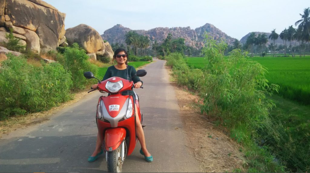 Traveling on a scooter in Hampi