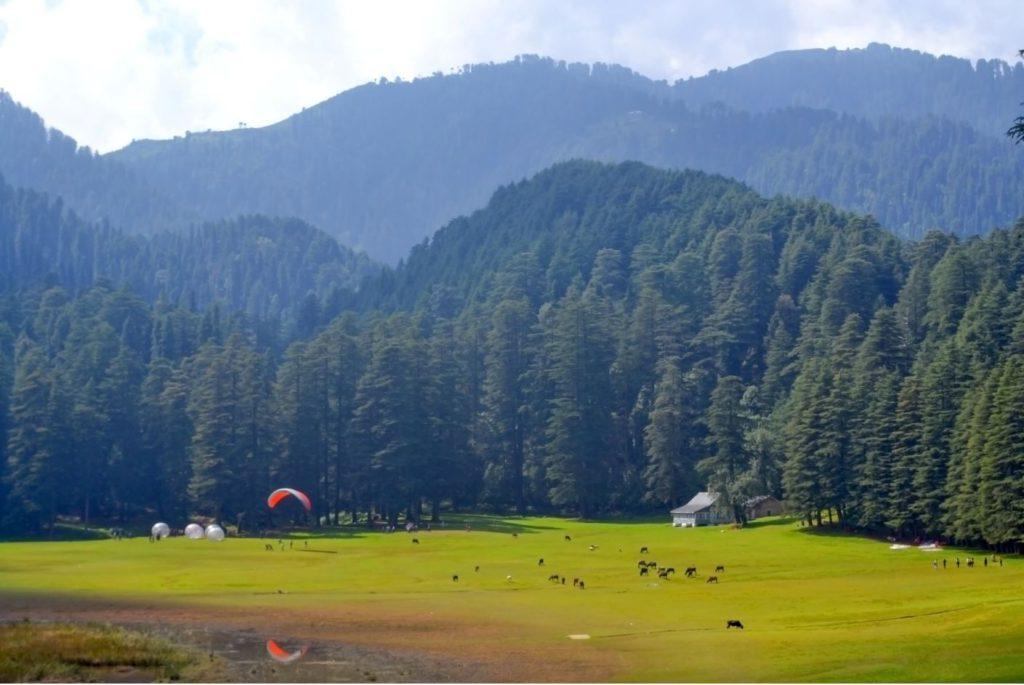 Khajjiar Meadow with people enjoying adventure sports