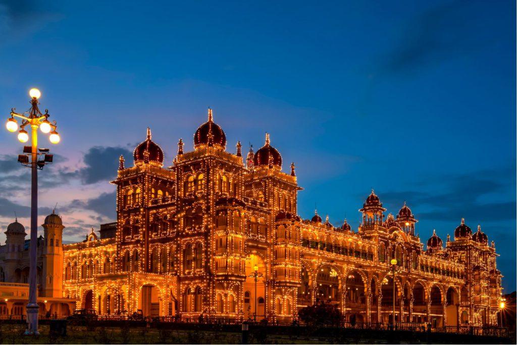 Mysore Palace lit at night, day trip to Mysore