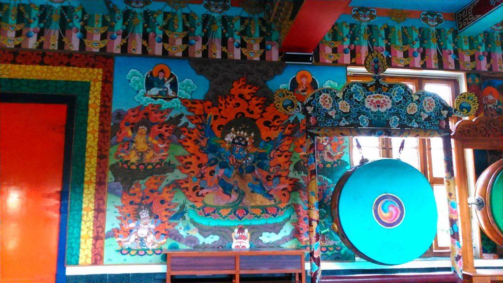 Paintings from Tibertan mythology inside monastery walls