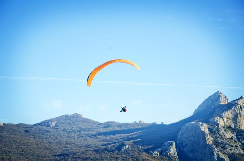 Paragliding with a view of the Himalayan ranges