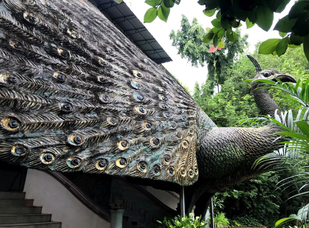 A sculpture of a large peacock