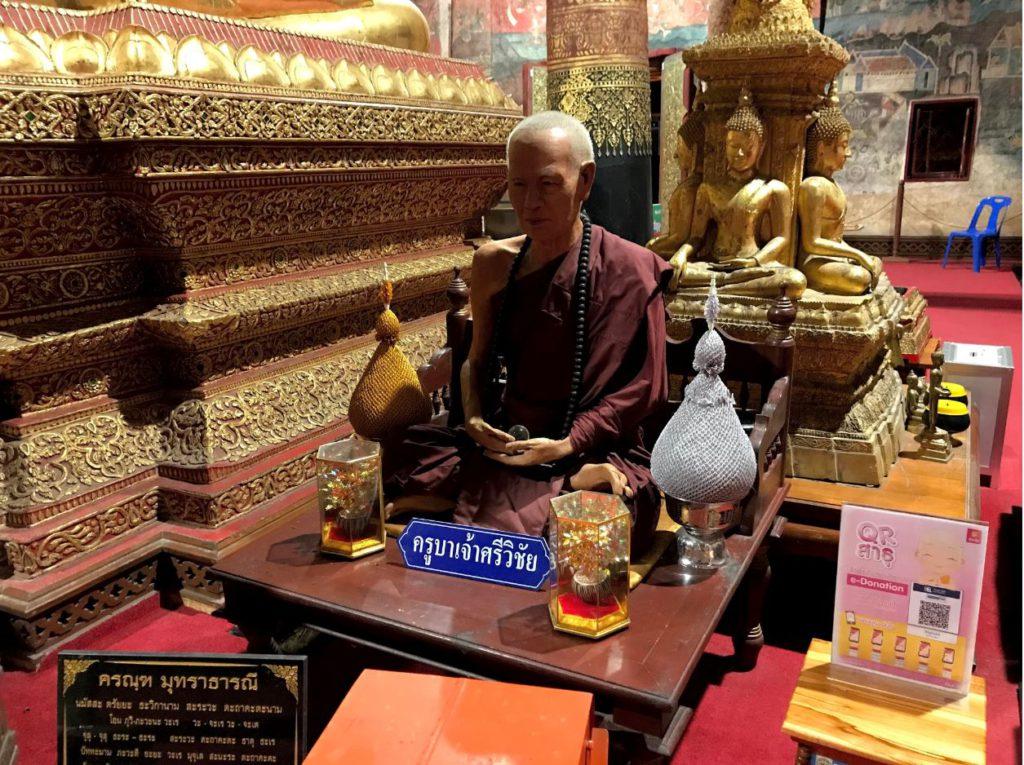 A fiberglass statue of a monk inside Wat Phumin
