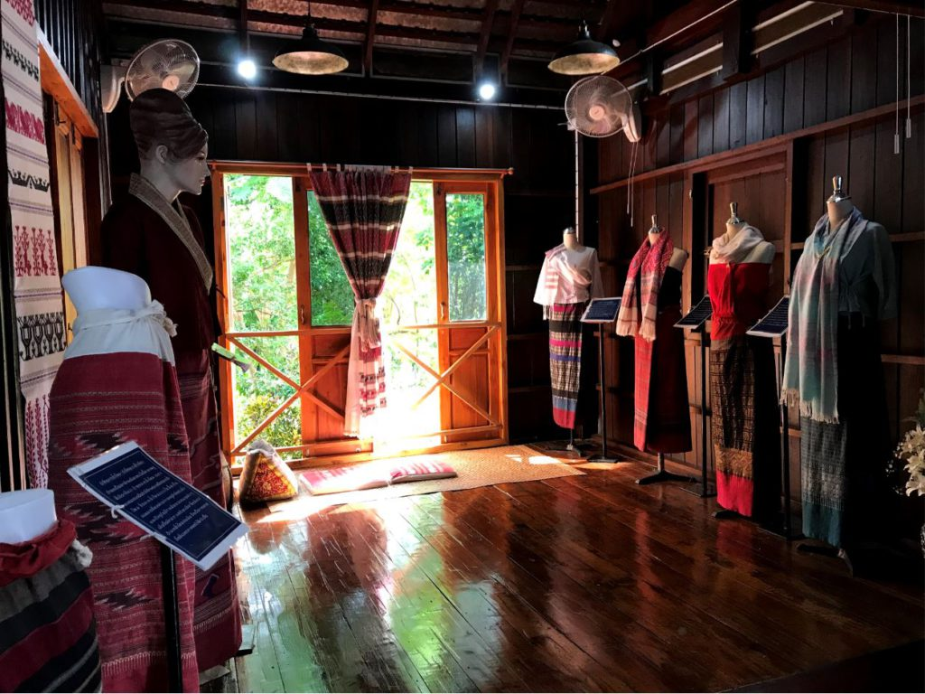 Local weaving garments inside The Noble House