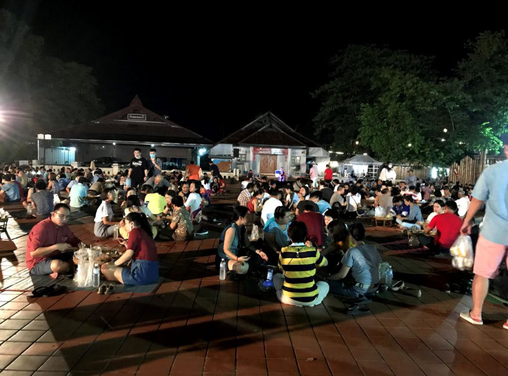 People seated to eat at the Night market inside Wat Phumin premises