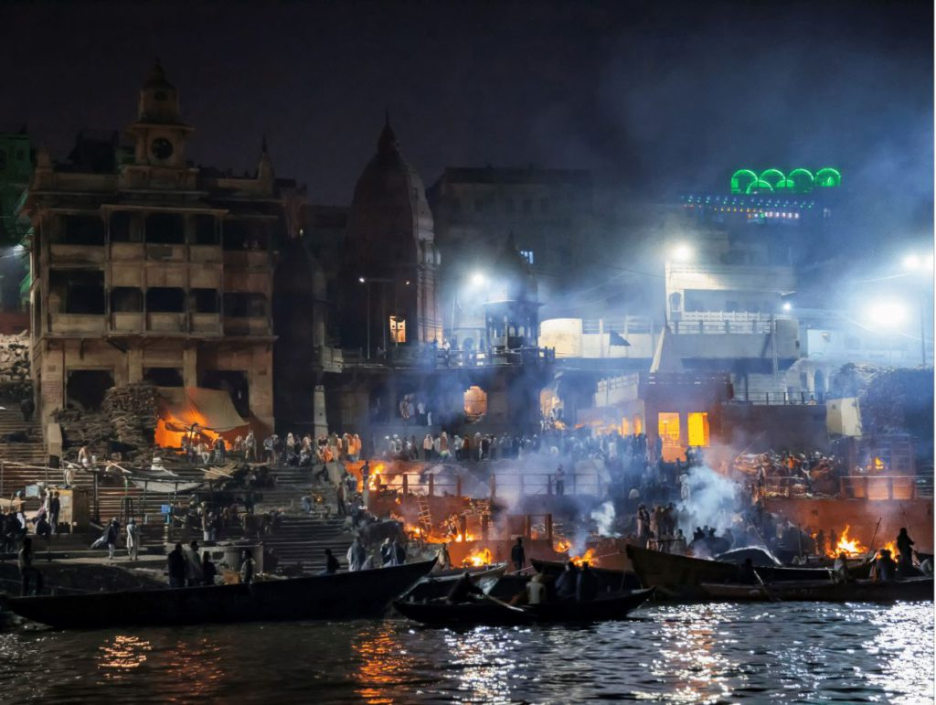 Manikarnika Ghat at night with burning pyres