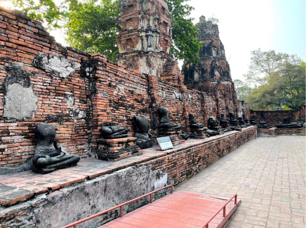 A series of burned Buddha statues around Wat Maha That, Ayutthaya