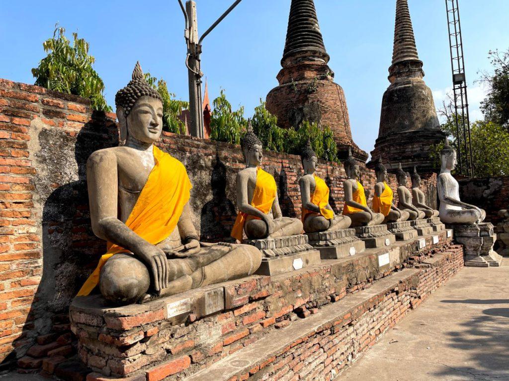 Buddha statues in a row around the pagoda, Ayutthaya