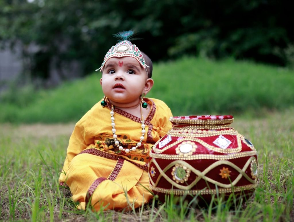 A baby dressed up as Lord Krishna on Janmashtami